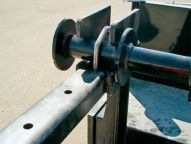 Adjustable reel lock down system.